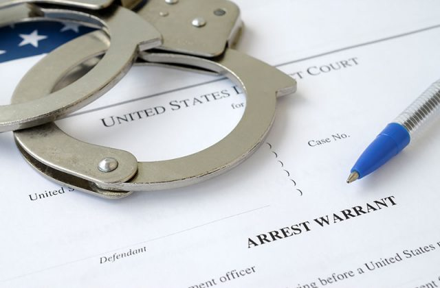 Handcuffs on arrest warrant